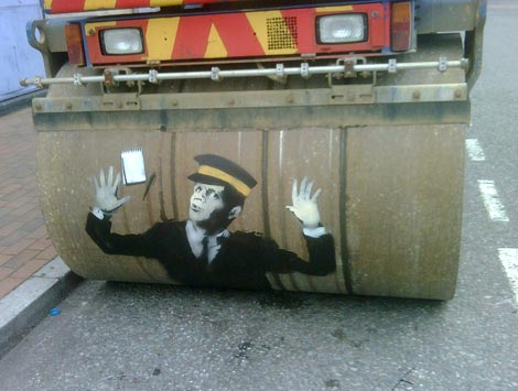 """Steamroller Traffic Warden,"" street art by Banksy"