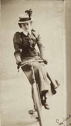 "Riding a bike ""side-saddle"" style. (source)"